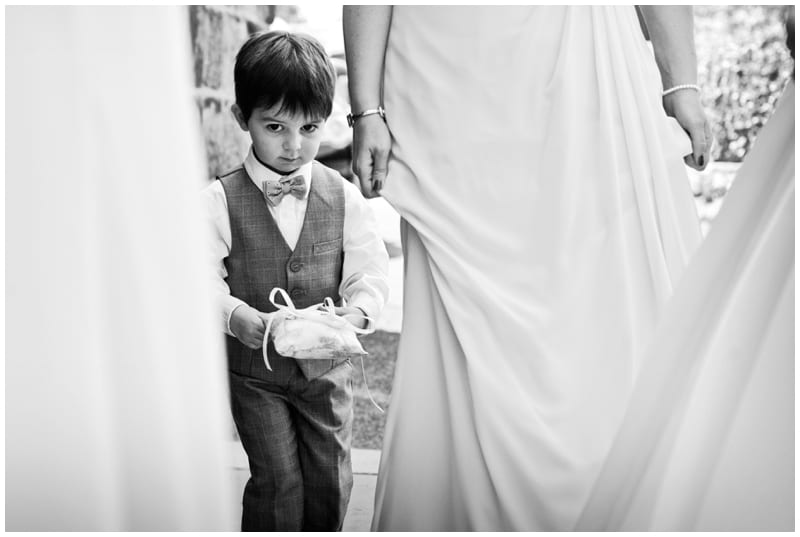 page boy carrying ring at wedding