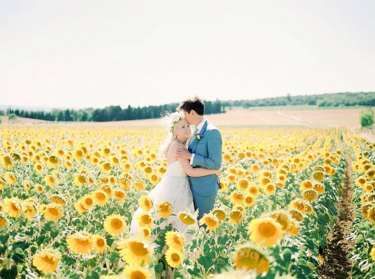 bride and groom in a filed of French sunflowers