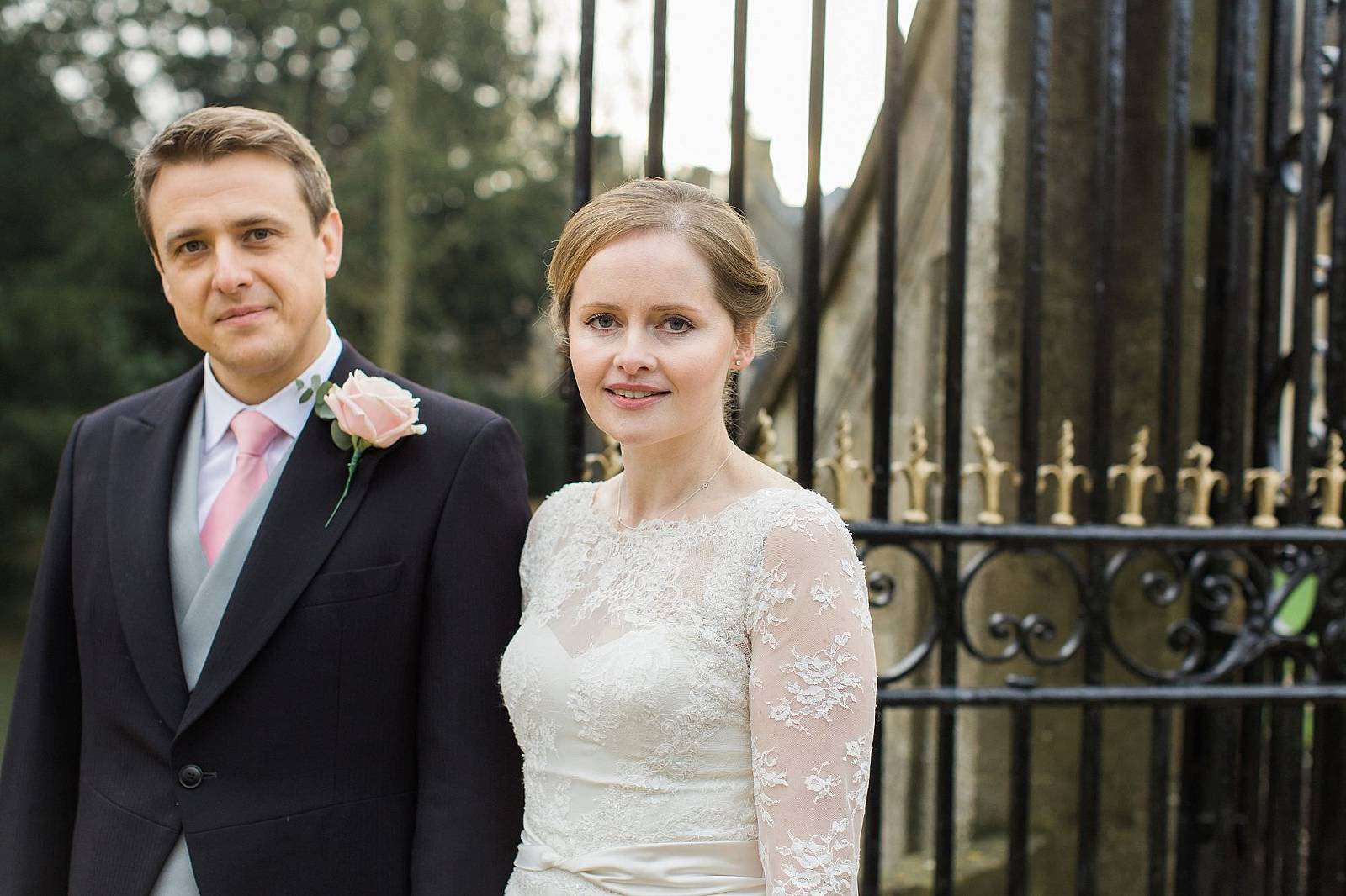 bride and groom at the gates Magdalen College