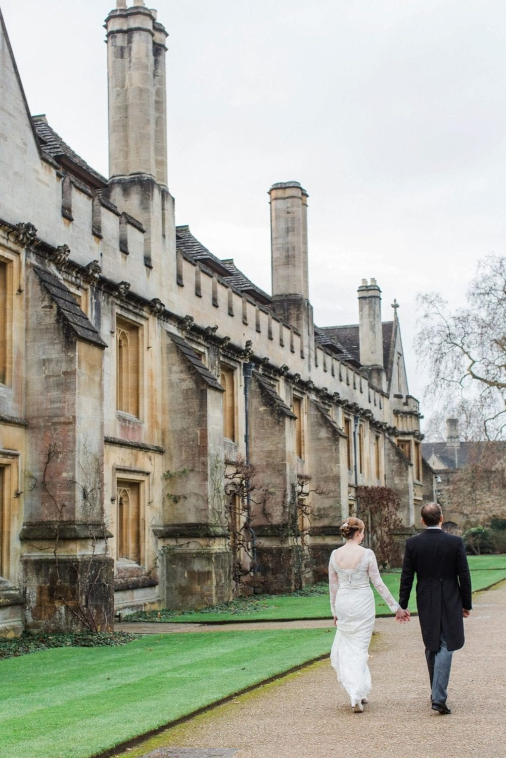 bride and groom walking through the grounds of Magdalen College