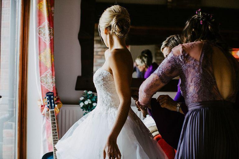 bride getting into her pronovias dress