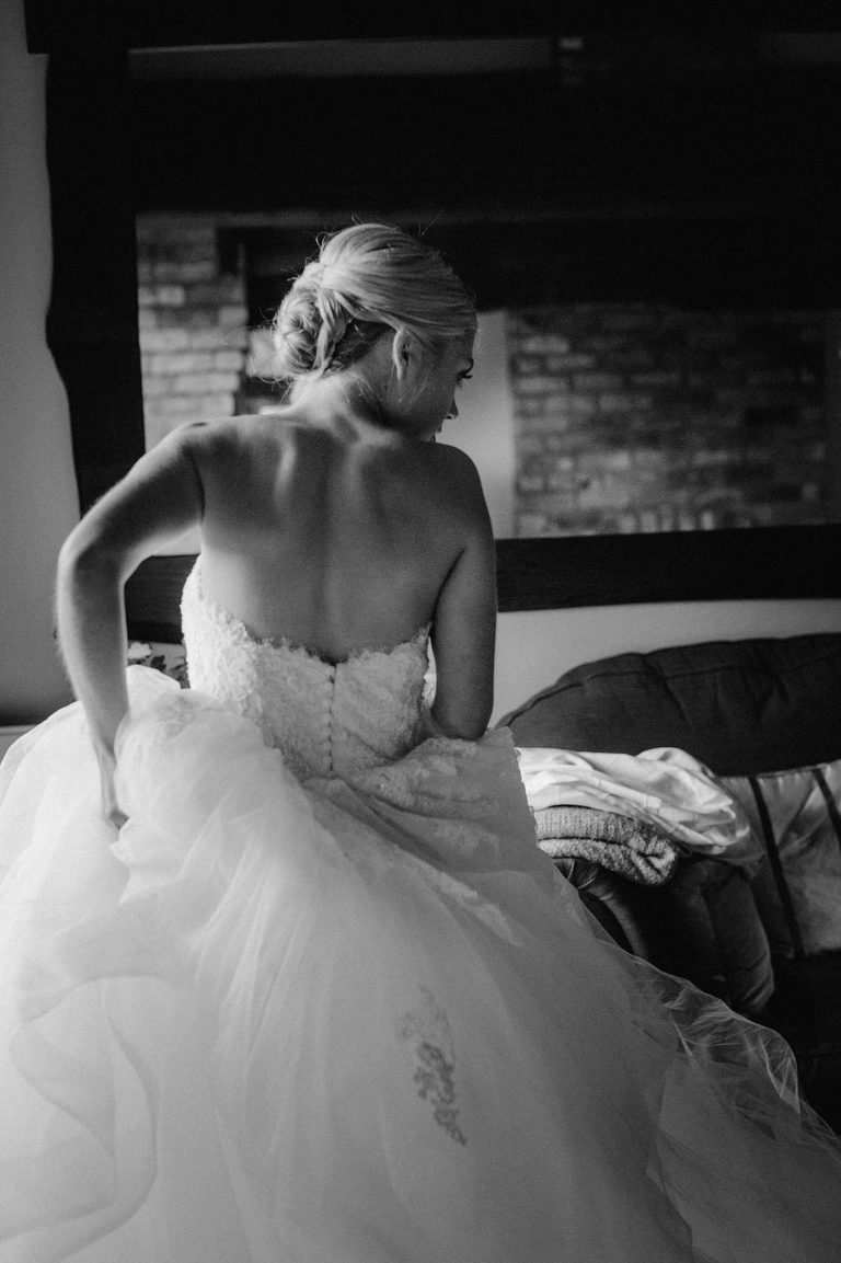 black and white image of bride in her pronovias dress